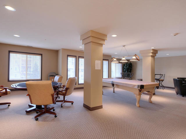 Another view of the social room in the B building shows the pool table and the great large windows facing east that make this such a comfortable spot to enjoy.