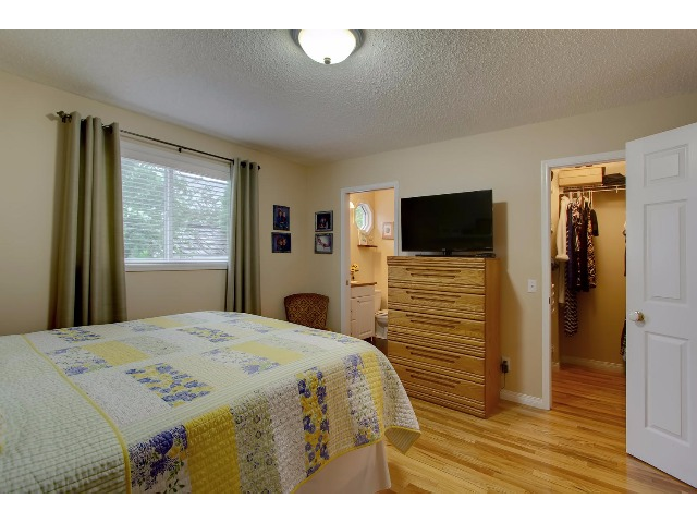 The Master bedroom has a large walk in closet at the right door and the en suite at the left entrance you can see to the right of the window.