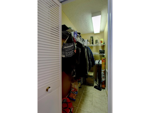 This extra walk in closet is in the space between master bedroom and dining room. You can use the space as you like. If you are a gourmet cook, organize it to hold all your extra kitchen stuff. or use as you require.