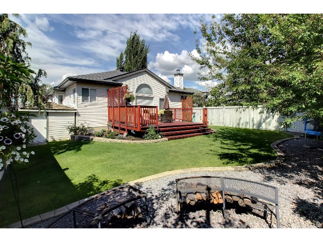 The fire pit in the yard will stay with the home along with the seating that matches the pit.