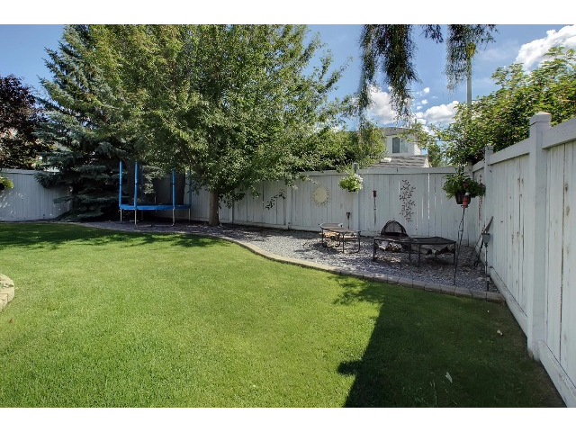 The lawn is expansive in this yard. The fence is in good shape and the trees are getting mature. Just move in and start entertaining or relaxing... the choice is yours.